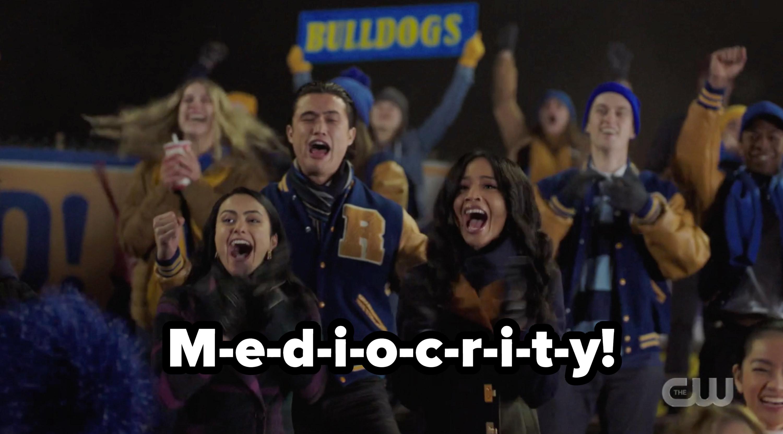 The crowd cheering m-e-d-i-o-c-r-i-t-y