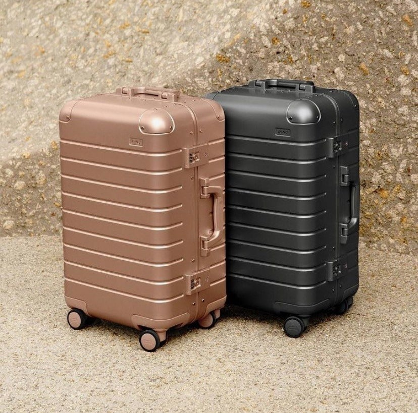 the suitcases in gold and black