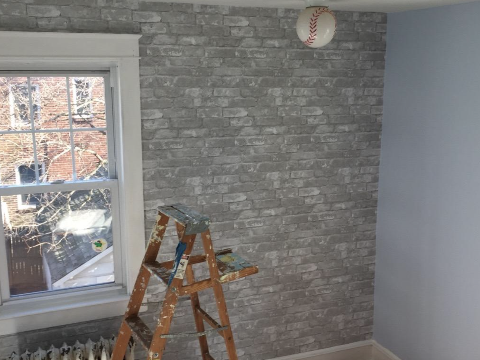 A customer review photo of their wall with the freshly installed wallpaper