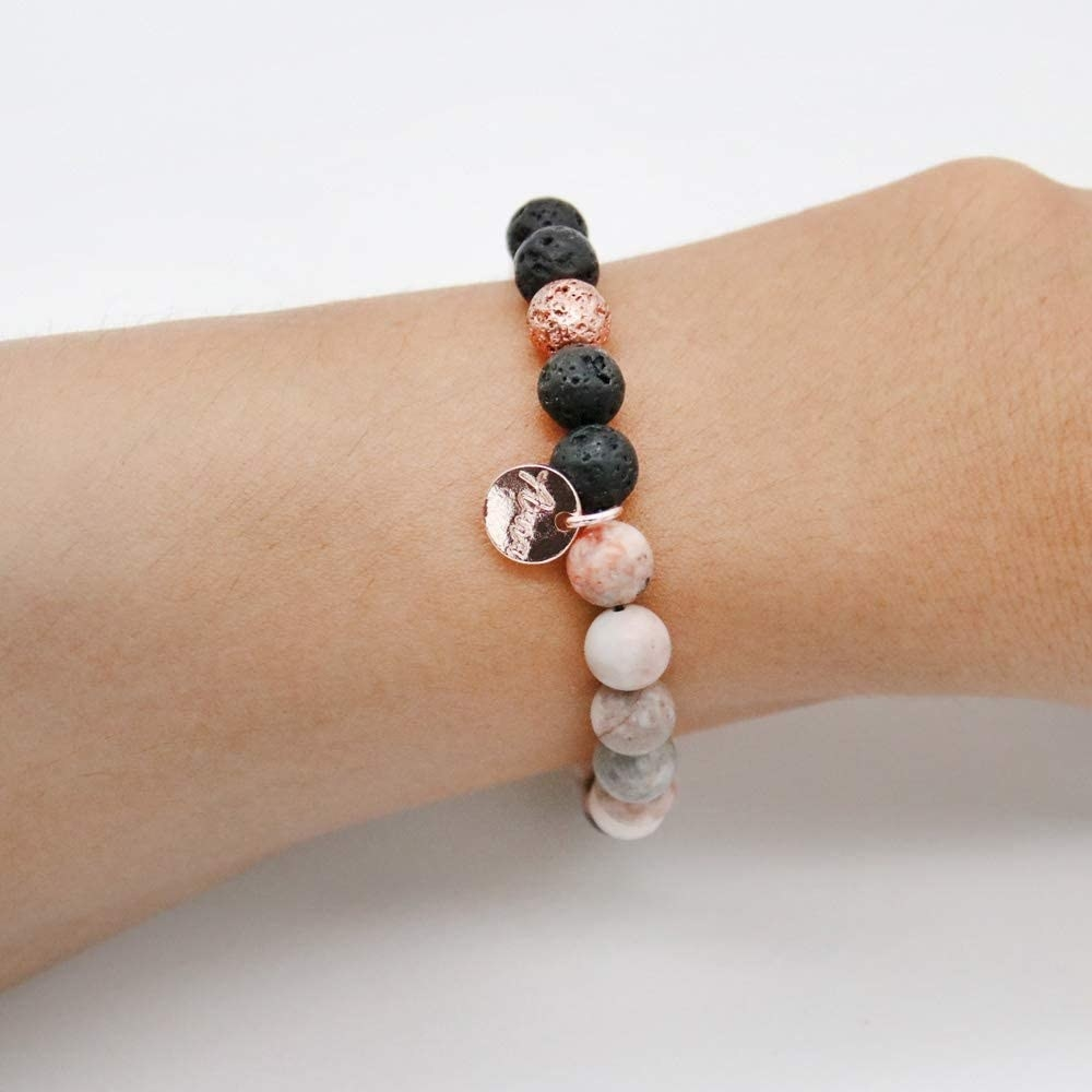 Bracelet with round stones. It stretches on and the lava rocks can be filled with the oil provided