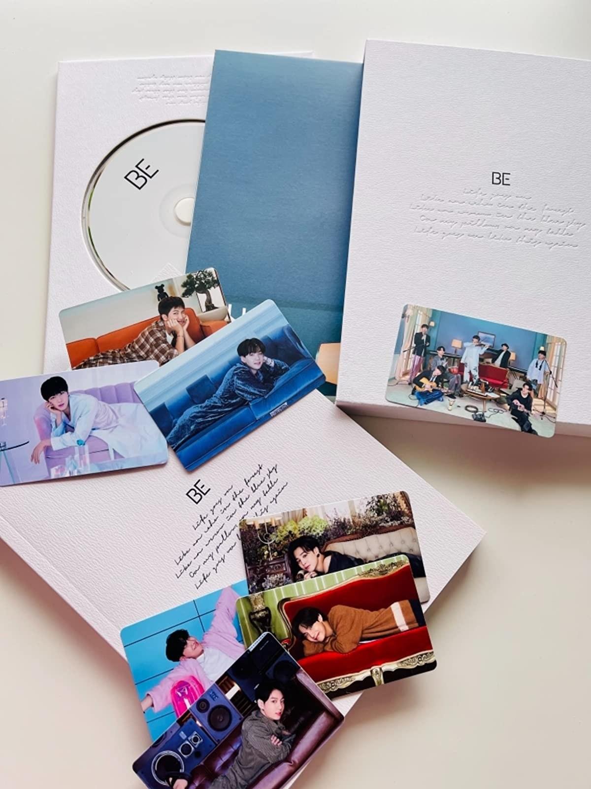 BTS' BE album with goodies around it