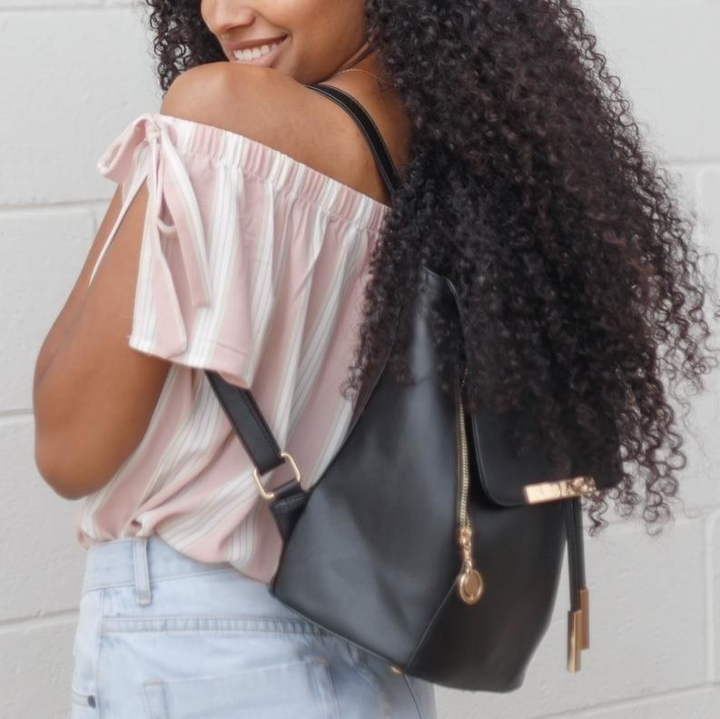 Reviewer wearing the black bag