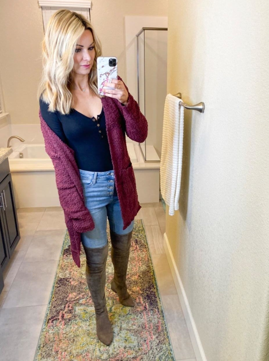 Reviewer wearing the tea rose chunky knit sweater