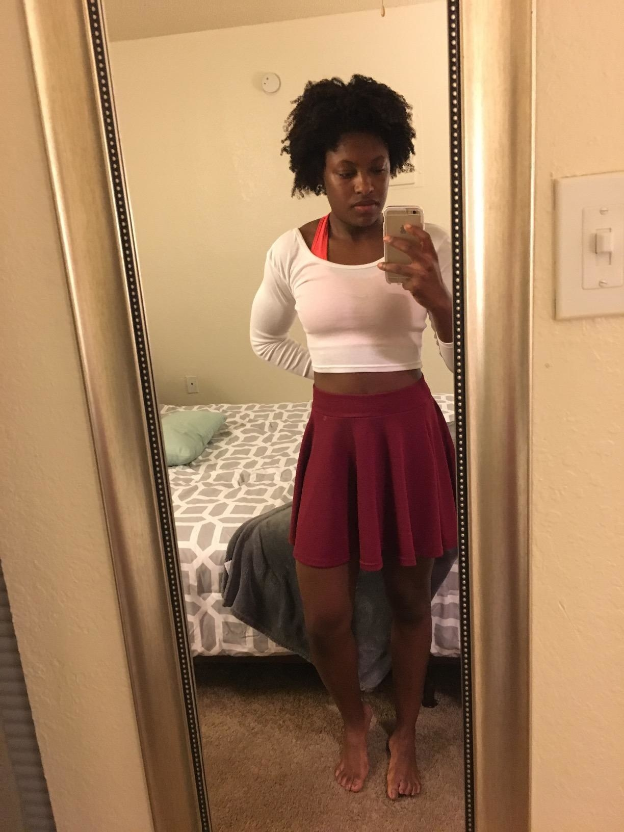 Reviewer wearing the wine red skater skirt