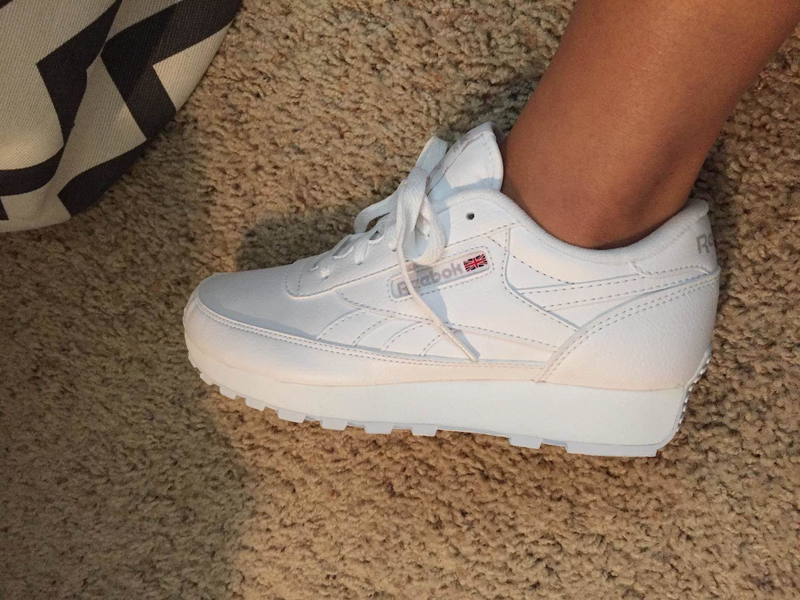 Reviewer wearing the white sneakers