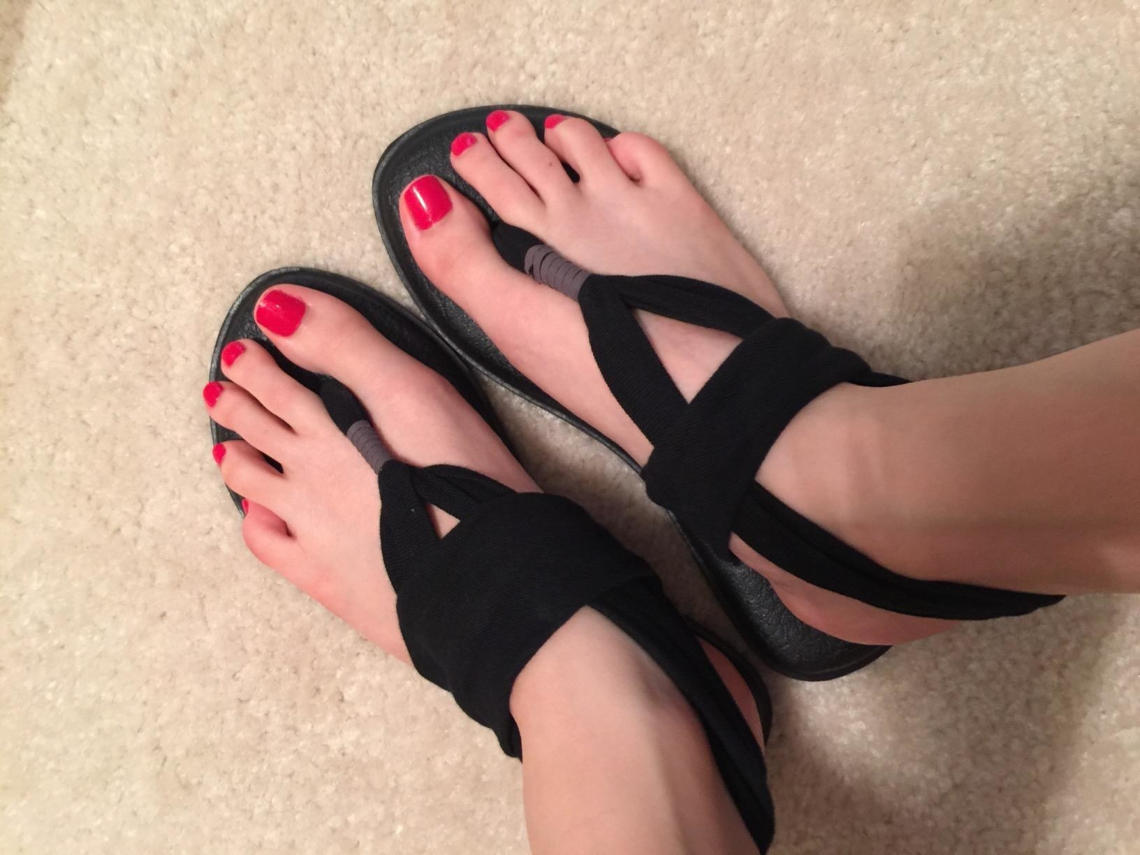 Reviewer wearing the black yoga sling sandals