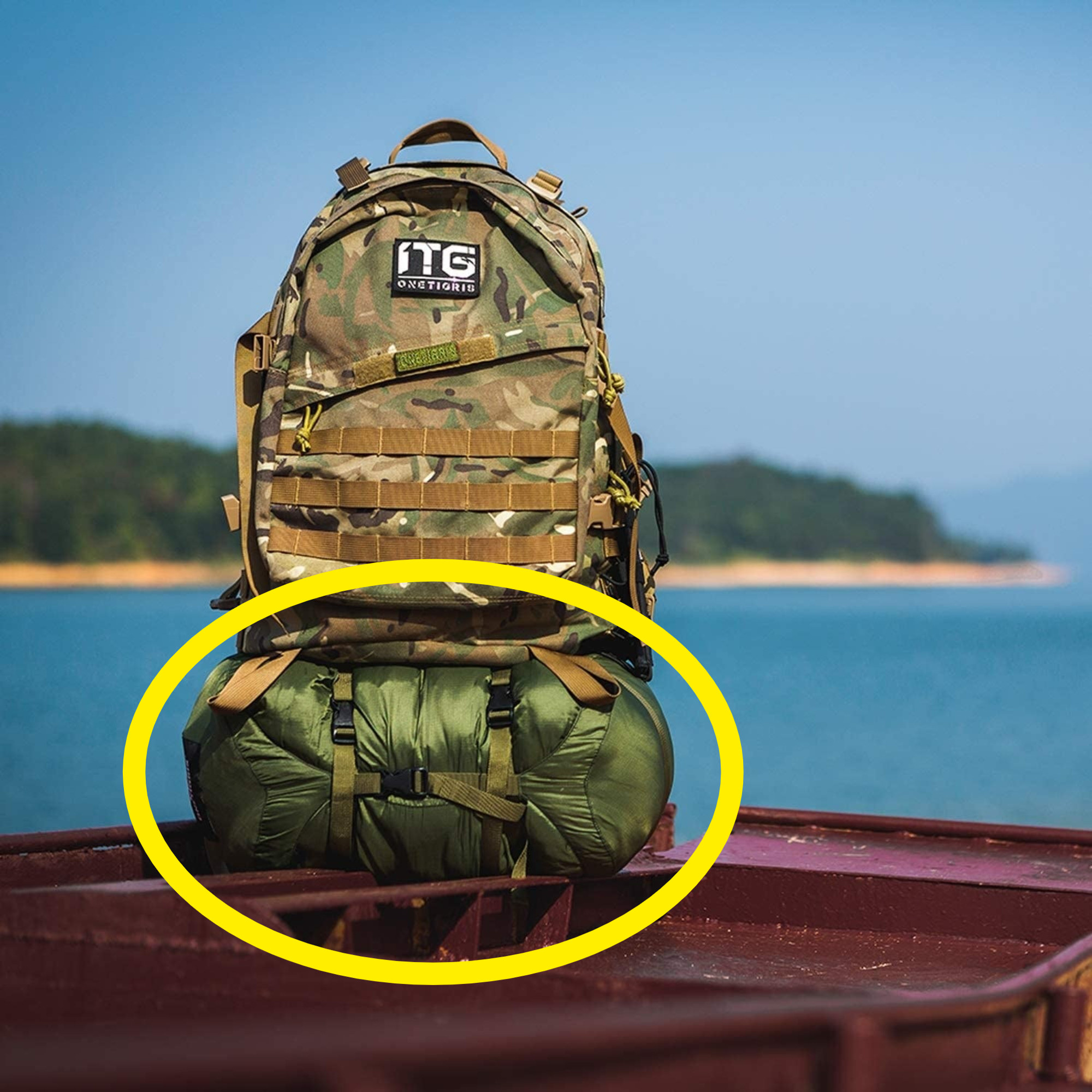 The compression sack attached to the bottom of someone's hiking pack