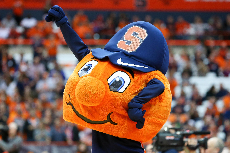Syracuse orange ball mascot wearing a Syracuse hat.