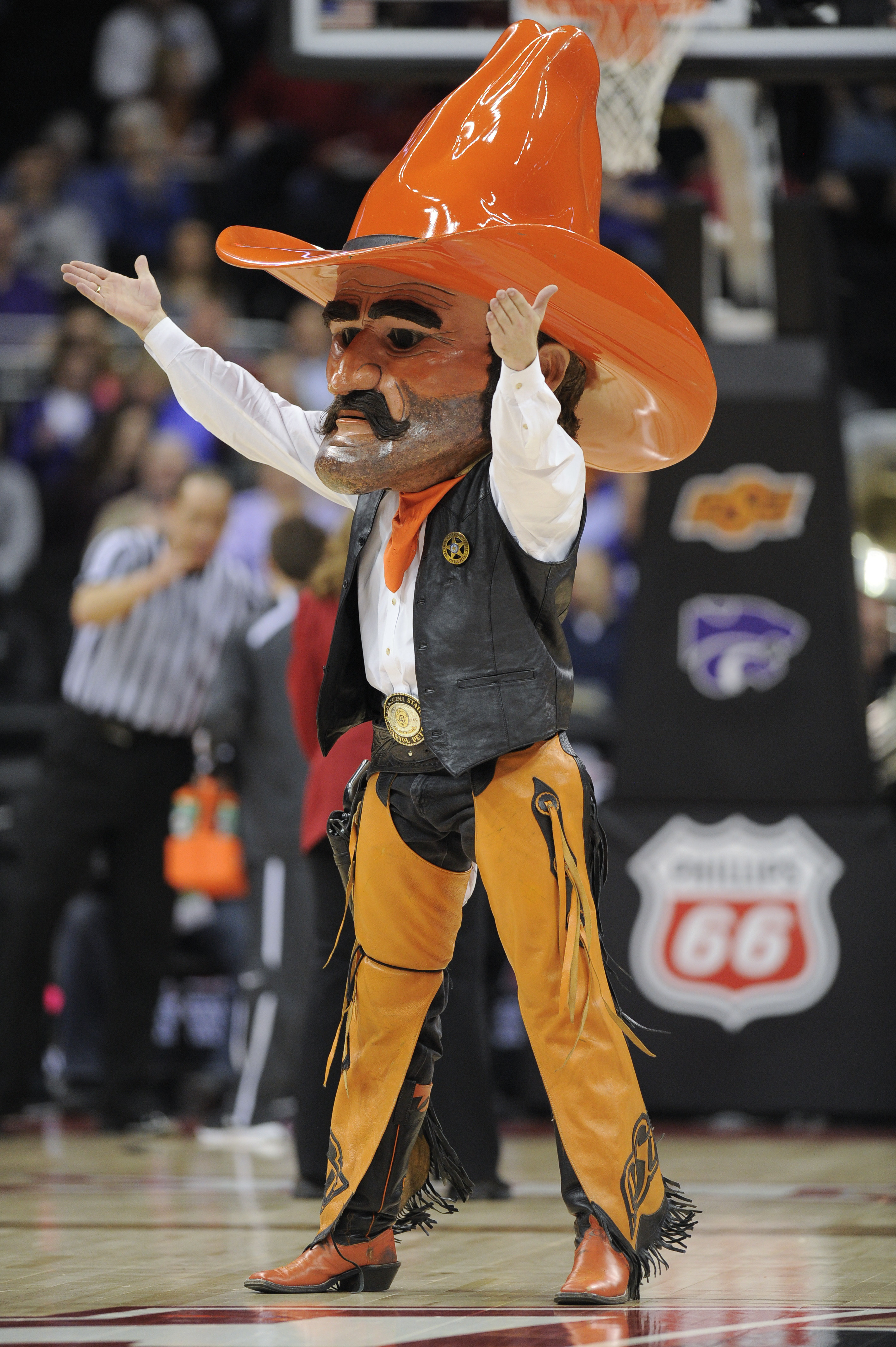 Cowboy mascot with giant head and cowboy hat.