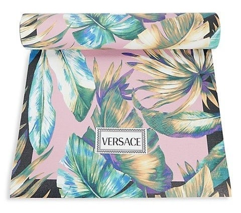 Pink yoga mat with colorful leaf print and Versace logo