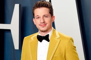 Charlie Puth wearing a bright suit with a bow tie and a watch