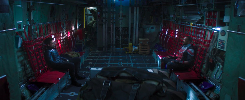 Sebastian San and Anthony Mackie sitting on a cargo plane