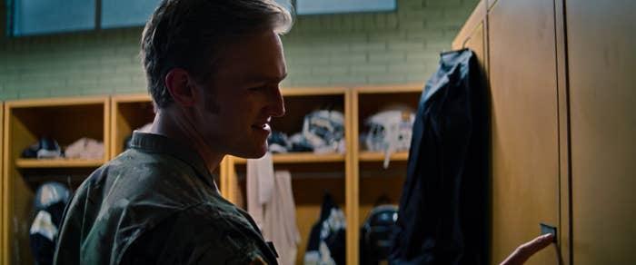 Fake Captain America looking at a locker