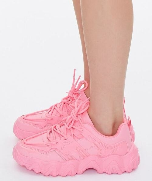 model wearing bubblegum pink sneakers