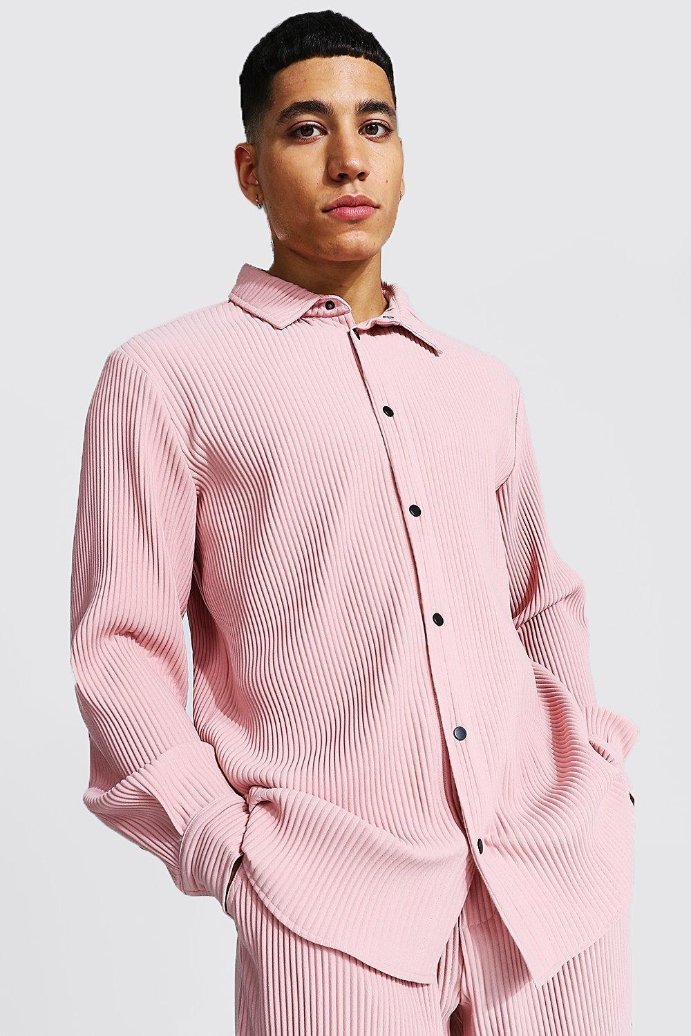 Model in a pleated pink shirt and matching pants