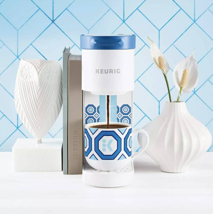 The mini Keurig coffee maker in white and blue