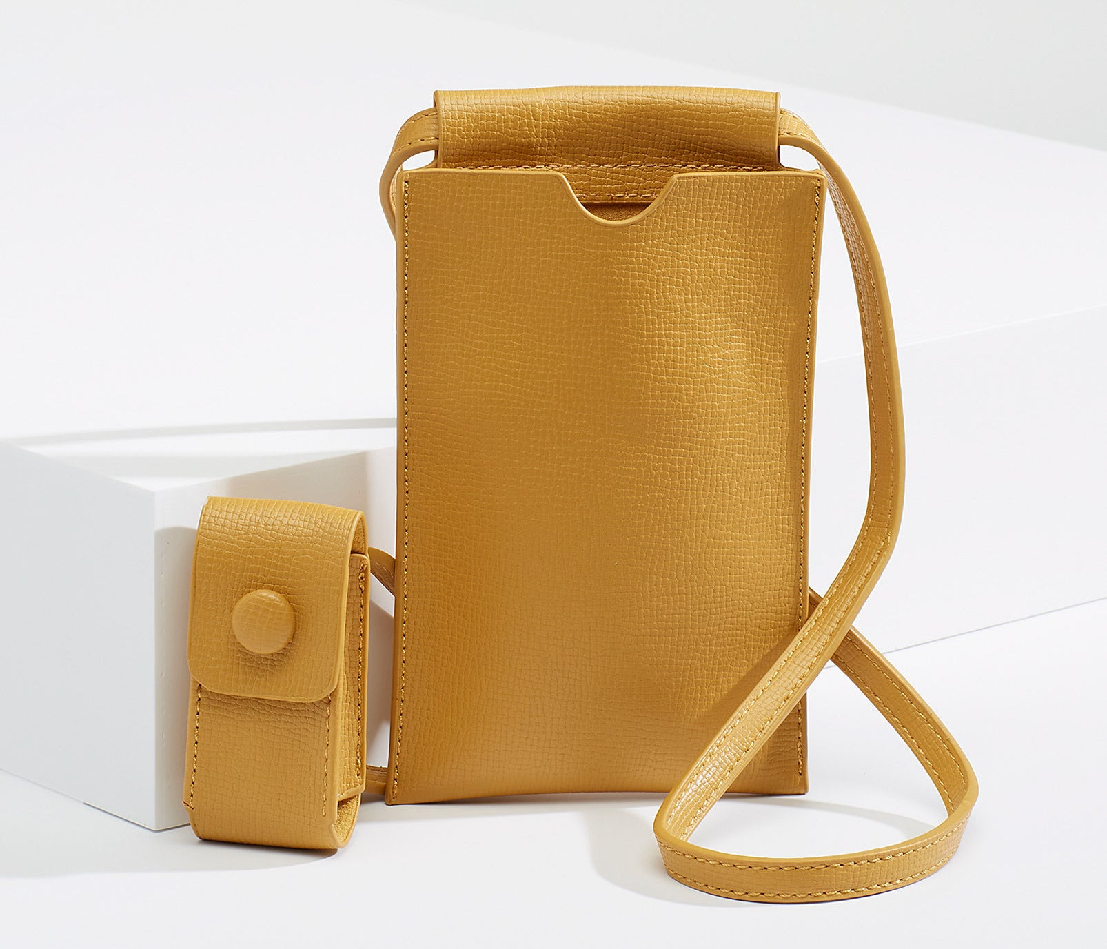 A small crossbody bag with a long strap