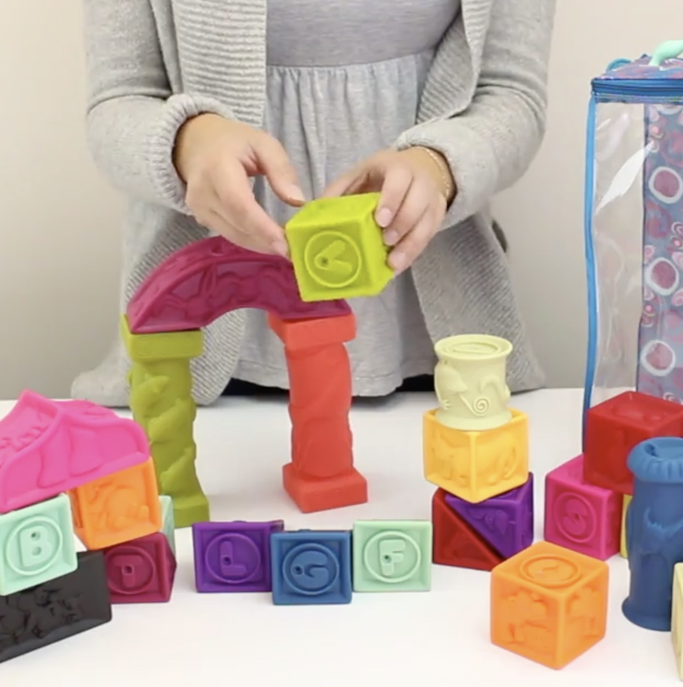 A person holding baby blocks