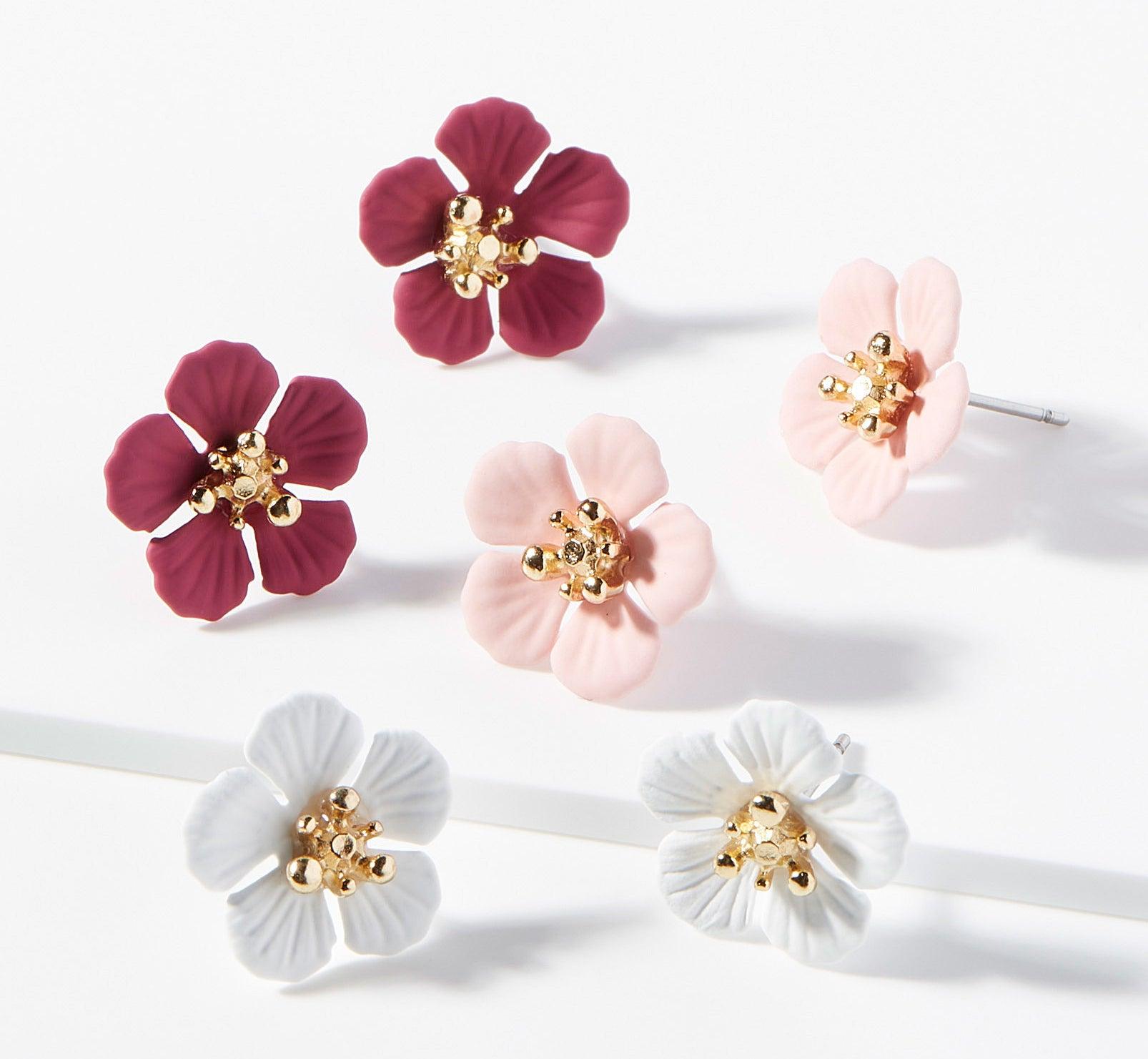 Three pairs of flower-shaped earrings