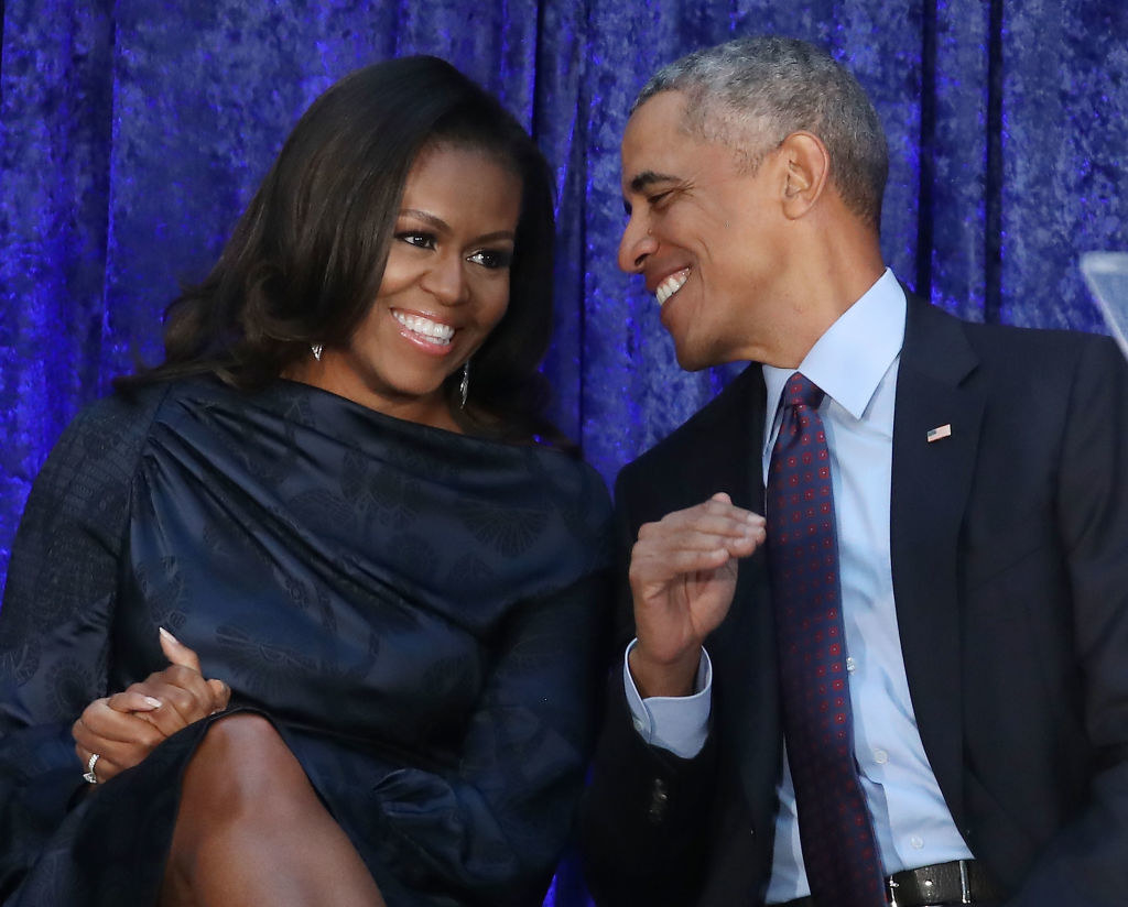 Michelle and Barack Obama smiling at each other