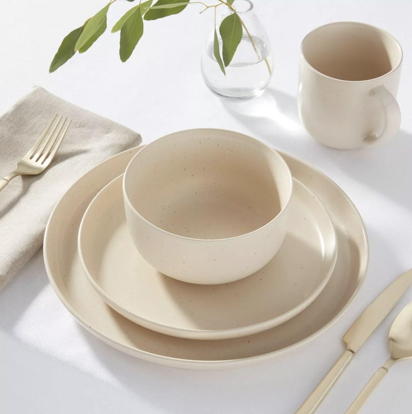 The dinnerware set in a cream white