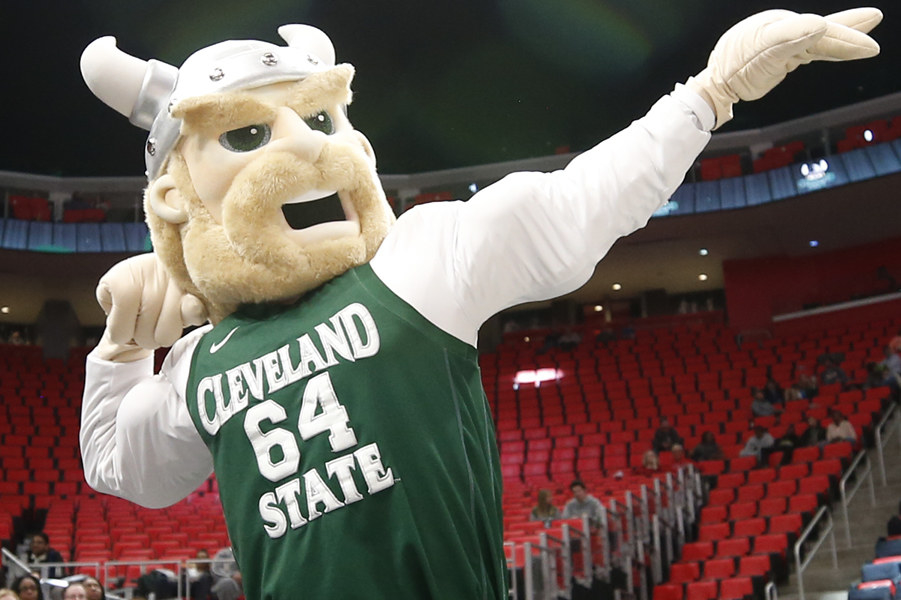 Viking mascot flexing in green Cleveland State jersey.