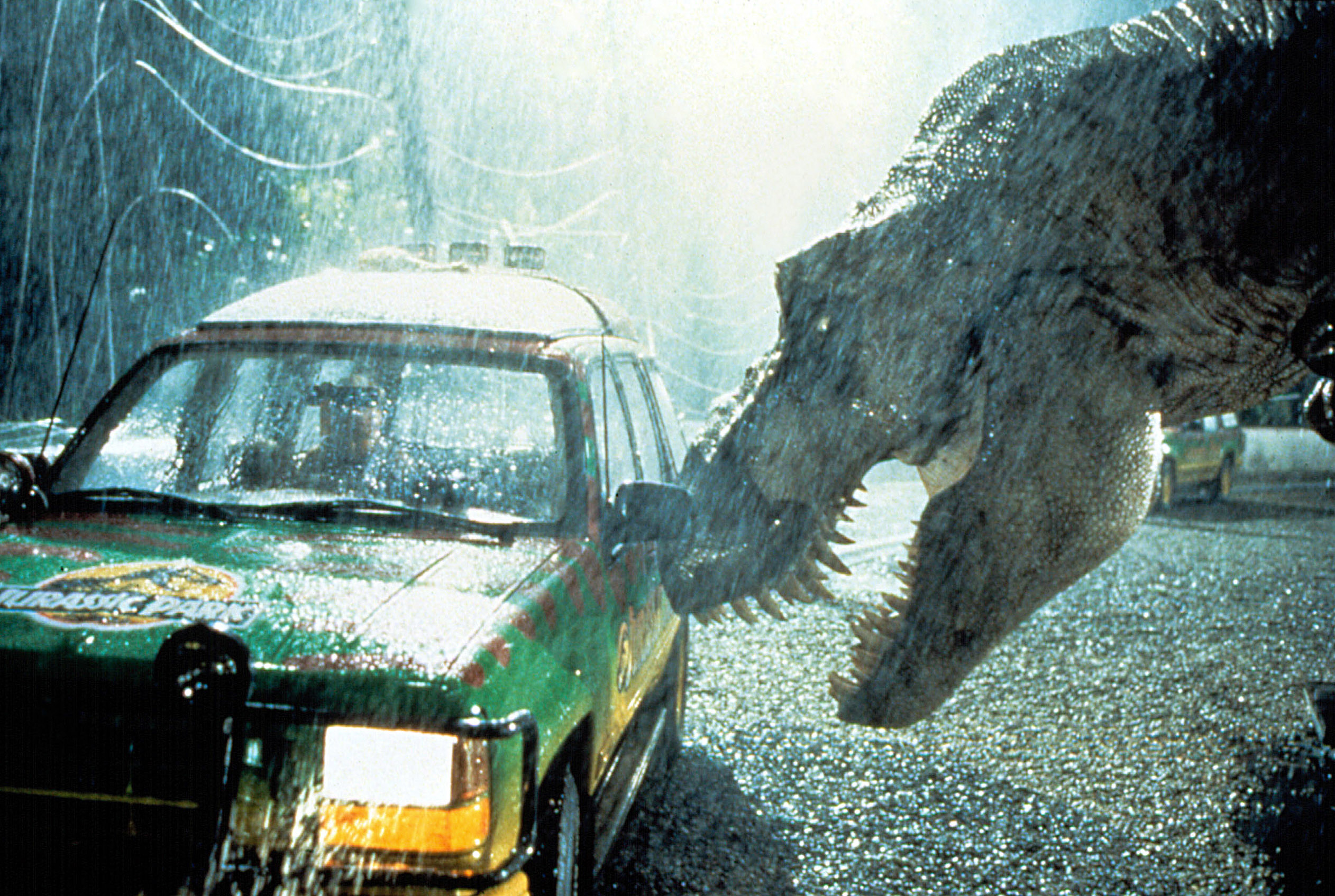 """A huge dinosaur approaches a car during a scene in """"Jurassic Park"""""""