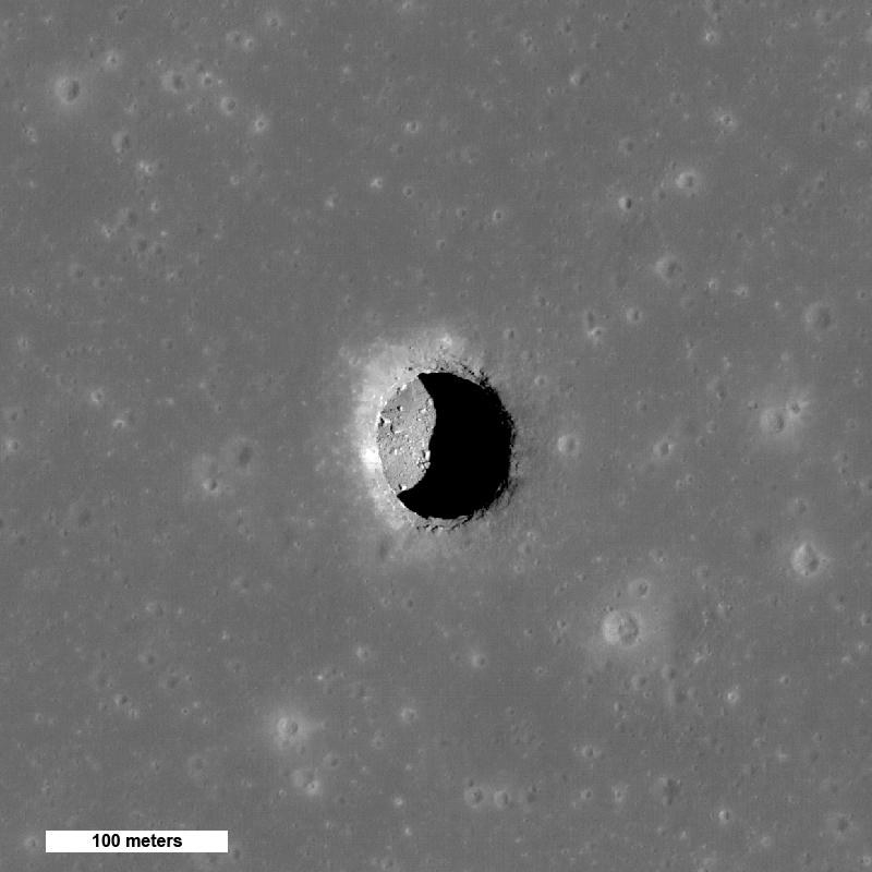 A deep pit crater on the moon's surface