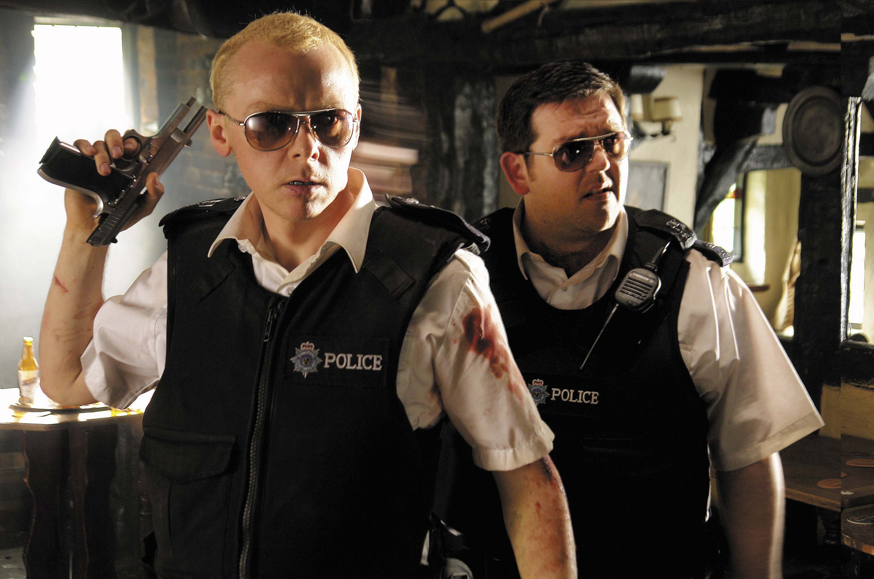 """A battered Simon Pegg and Nick Frost as police officers in """"Hot Fuzz"""""""