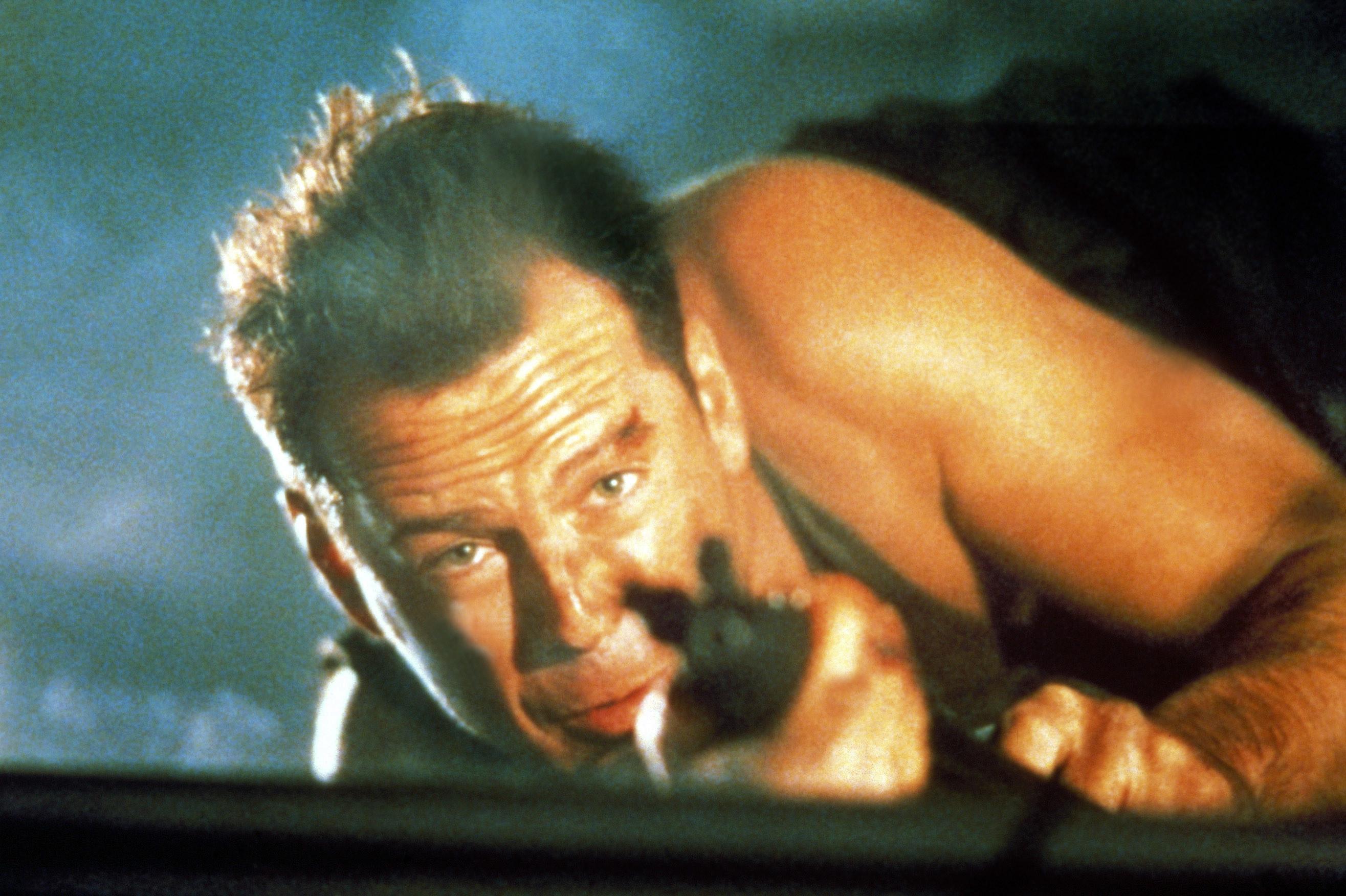 "A battered Bruce Willis in ""Die Hard"""