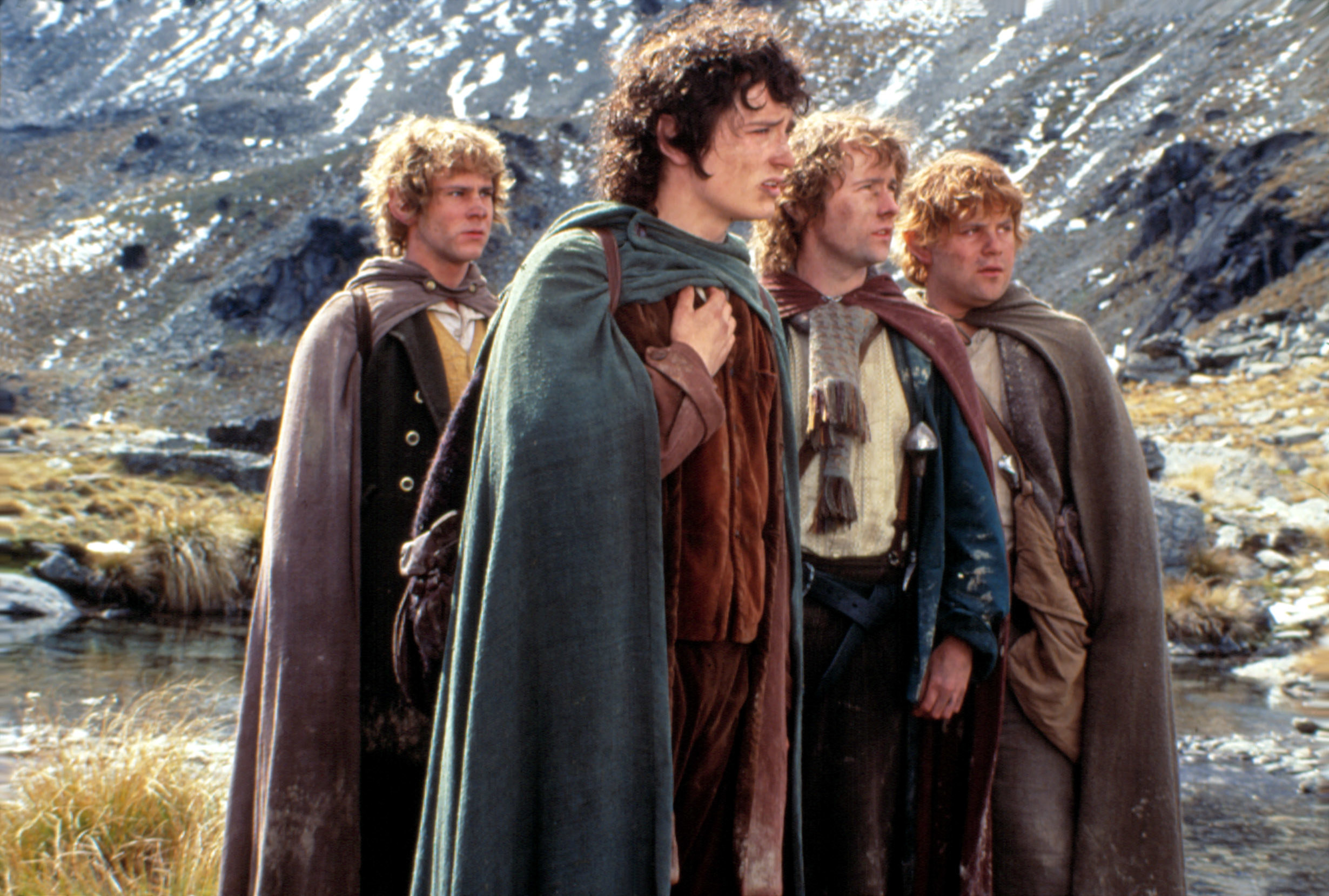 """Dominic Monaghan, Elijah Wood, Billy Boyd, and Sean Astin in the first """"Lord of the Rings"""" movie: """"Fellowship of the Ring"""""""