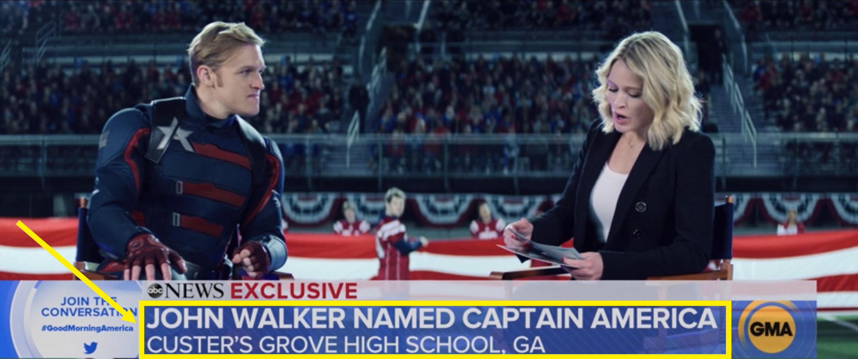 "A lower third graphic reading, ""John Walker named Captain America. Custer's Grove High School, GA"""
