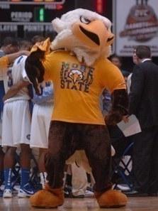 Bald eagle mascot wearing a yellow Morehead State shirt.