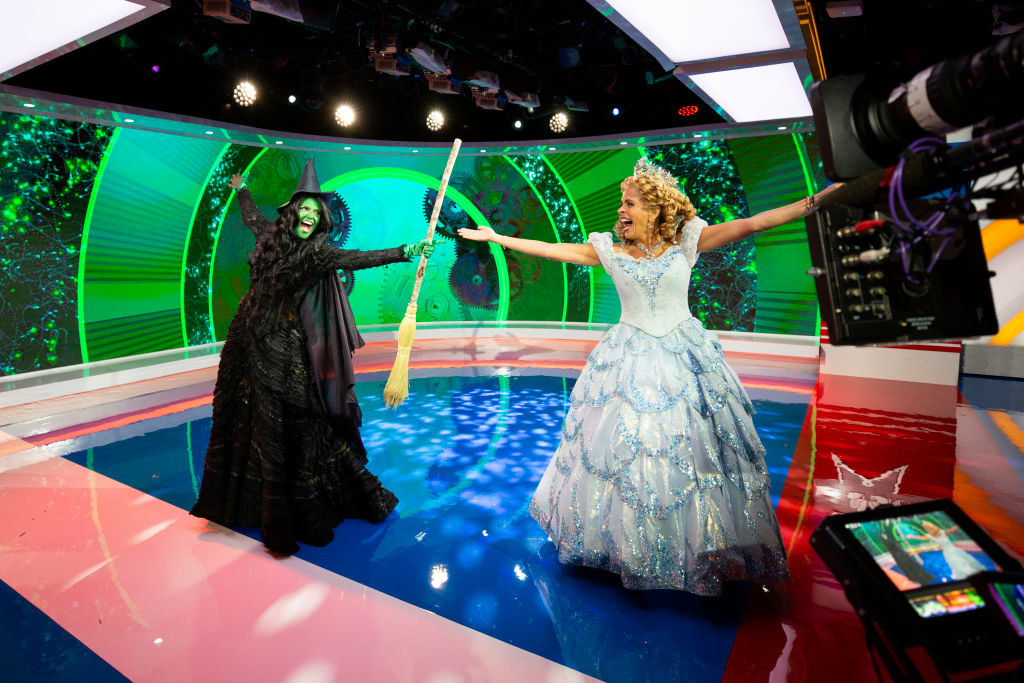 Glinda and Elphaba from Wicked performing onstage