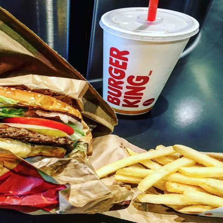 A Whopper meal from Burger King with a retro logo on the cup