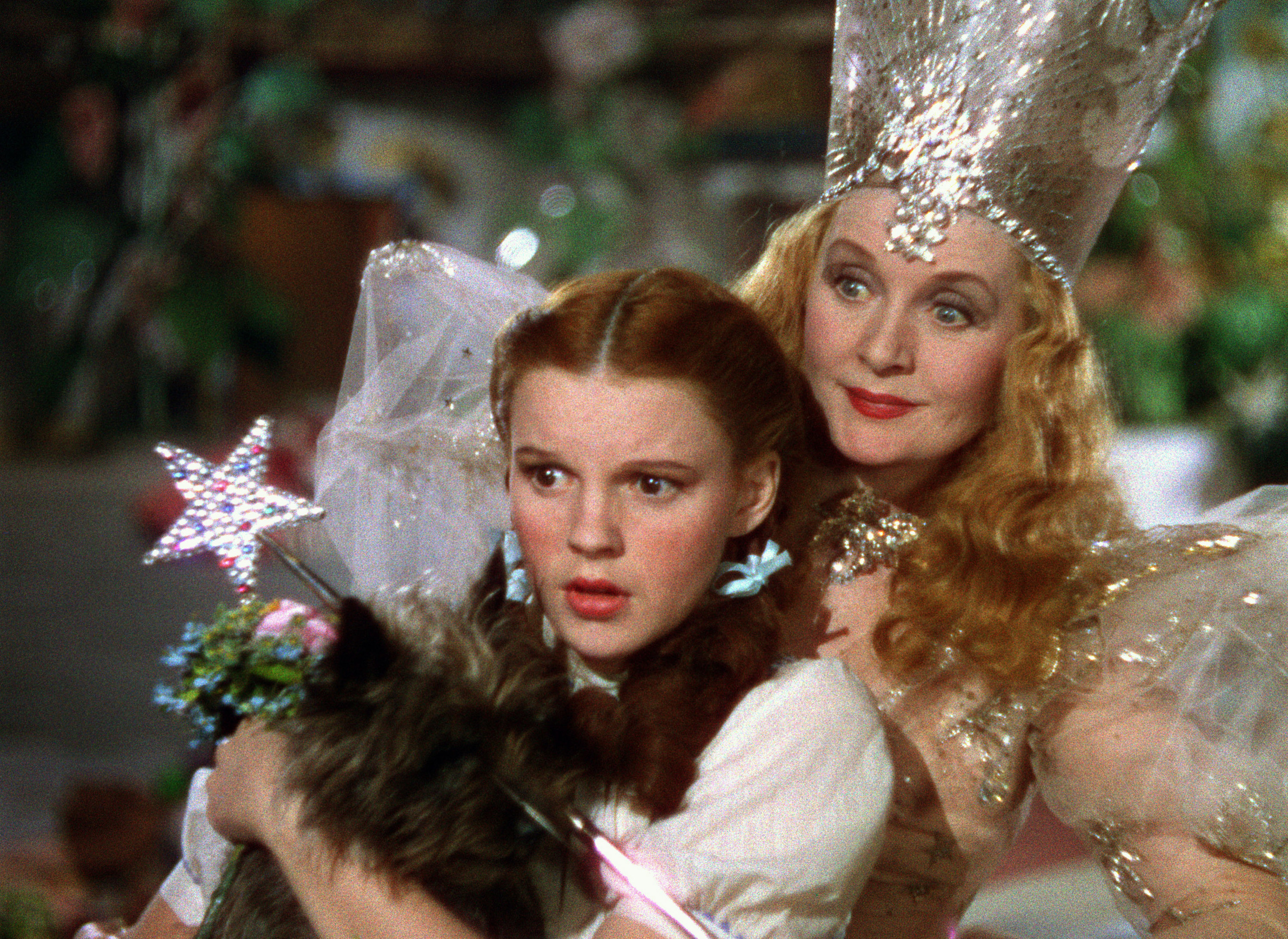 """Judy Garland as Dorothy with Glinda the Good Witch, played by Billie Burke, in """"The Wizard of Oz"""""""