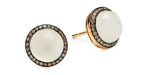 Gold stud earrings with moonstone circled by diamonds