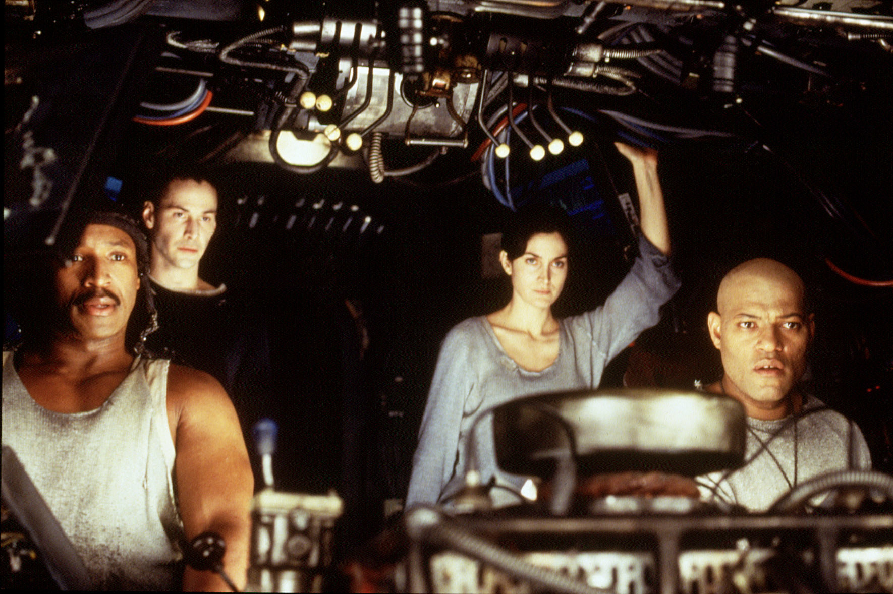 """Keanu Reeves, Carrie-Anne Moss, and Laurence Fishburne in """"The Matrix"""""""