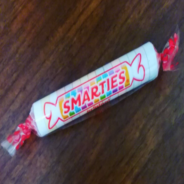 A package of Smarties hard candies, pastel candy wrapped in plastic
