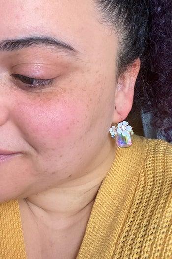 buzzfeed editor wearing the earrings