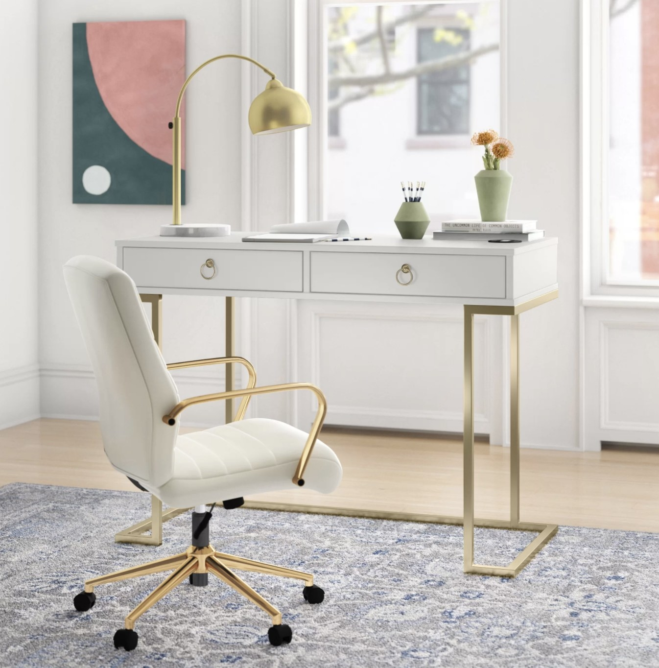 the desk in white with gold accents