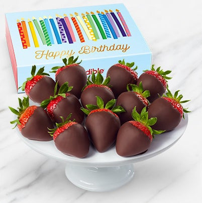 """The festive box printed with candles and the words """"Happy Birthday"""" and the strawberries"""