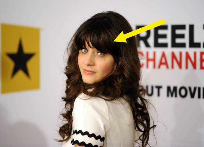 An arrow pointing at Zoey's bangs