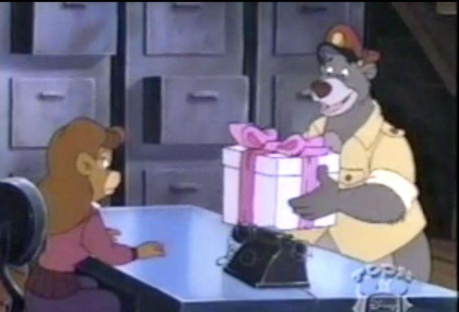 Baloo picks up a present