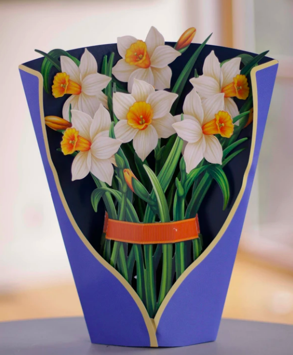 Paper bouquet of flowers standing upright on a table