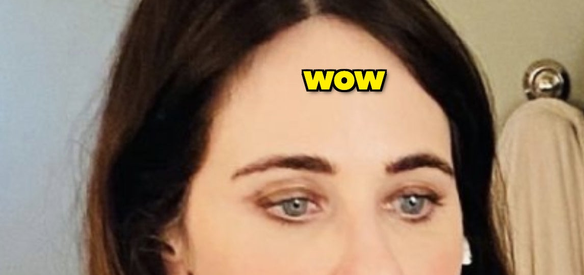 """Zooey Deschanel selfie of her forehead with the caption """"wow"""" written over it"""