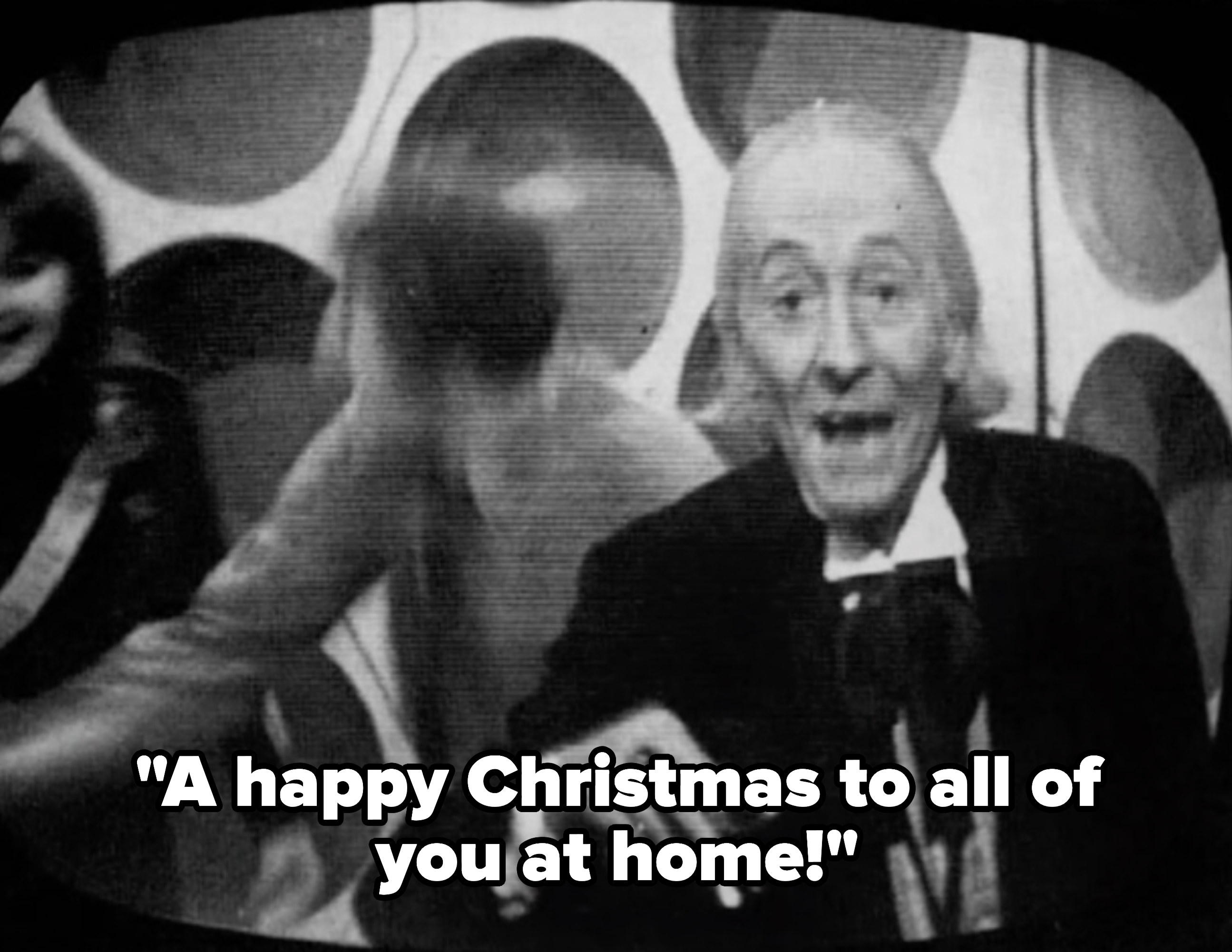 The Doctor wishing viewers a Merry Christmas