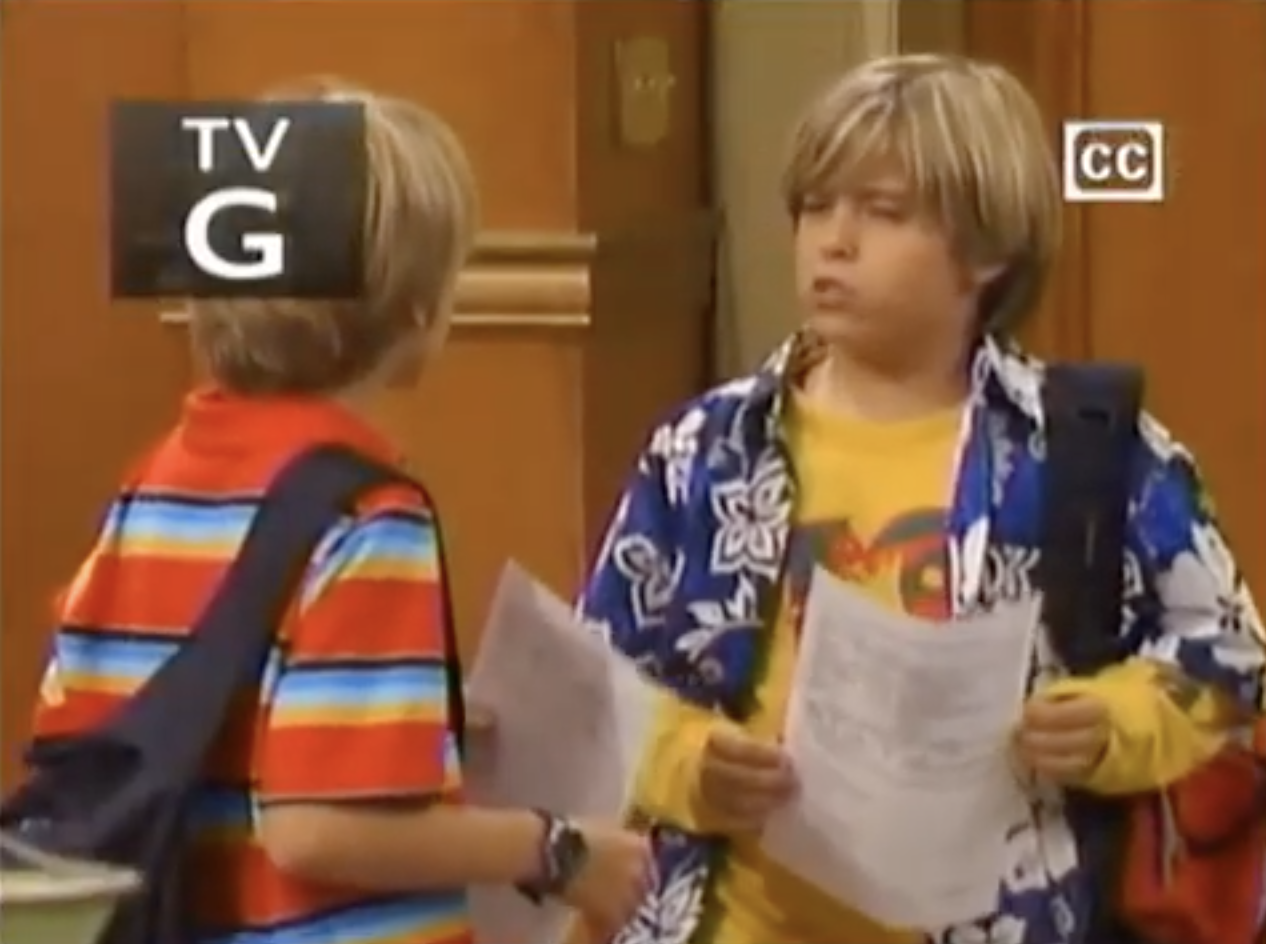 Cody and Zack holding their report cards and talking