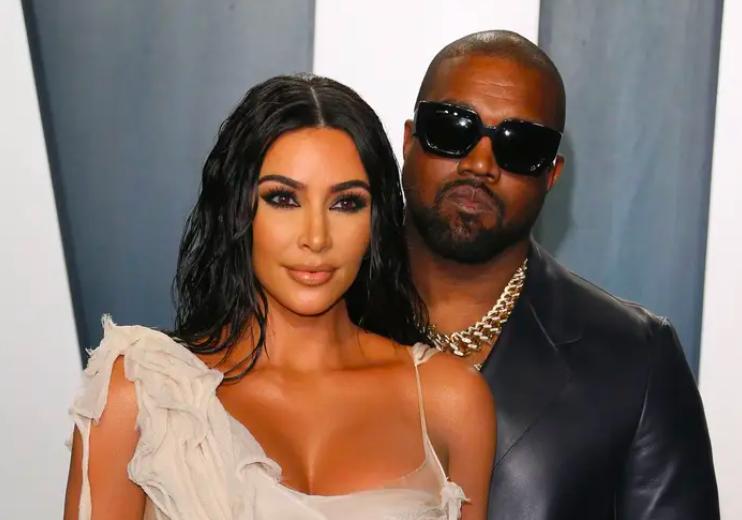 Kim and Kanye posing together