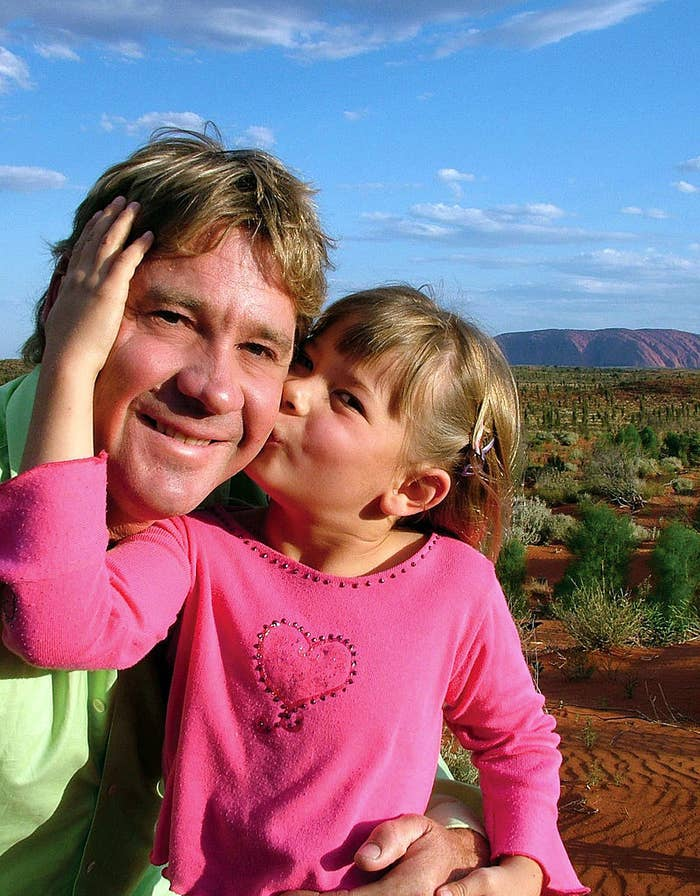A photo of a young Bindi kissing her dad on the cheek